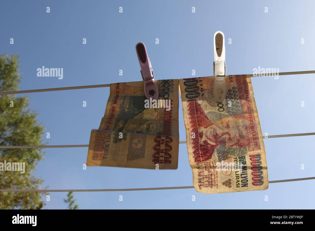 Turkish Lira Note 1 million lira, 1 BiR Milyon Turk Lirasi, hanging on washing line, money laundering concept Stock Photo