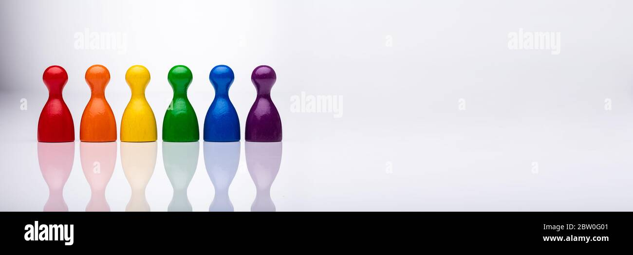 Recruitment Inclusion And Diversity. Leadership Group And Pawn Row Stock Photo
