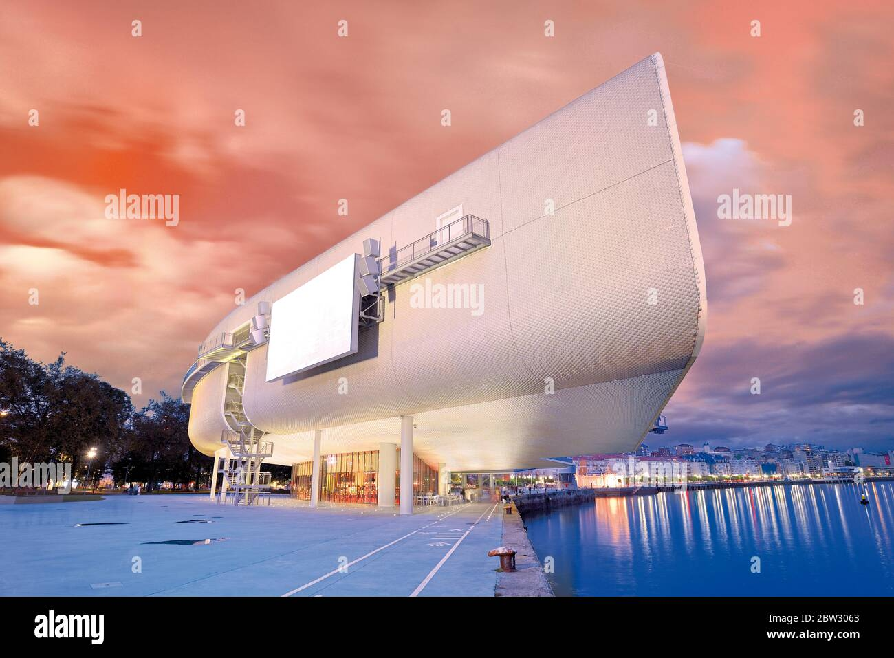 Scenic nocturnal view of modern and futuristic Centro Botin at seaside walking area of Santander Stock Photo