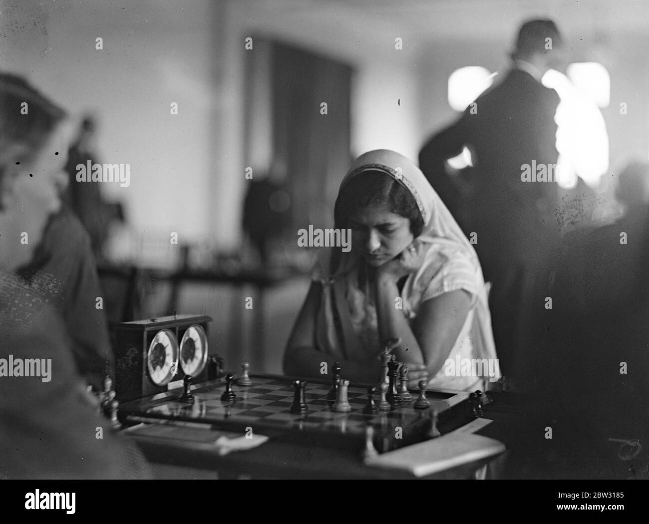 Indian girl concentrates in chess championship . Mrs Perin Mursah , an Indian girl who played in native sari , concentrating on a move during her match against Mr A J Duke in the British Chess Championship at the Empire Chess Club in London . 17 August 1932 Stock Photo