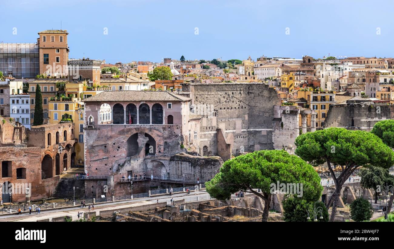 View at the Rome cityscape with House of the Knights of Rhodes and Forum Augustus at the foreground as seen from Piazza Venezia in Rome, Italy. Stock Photo