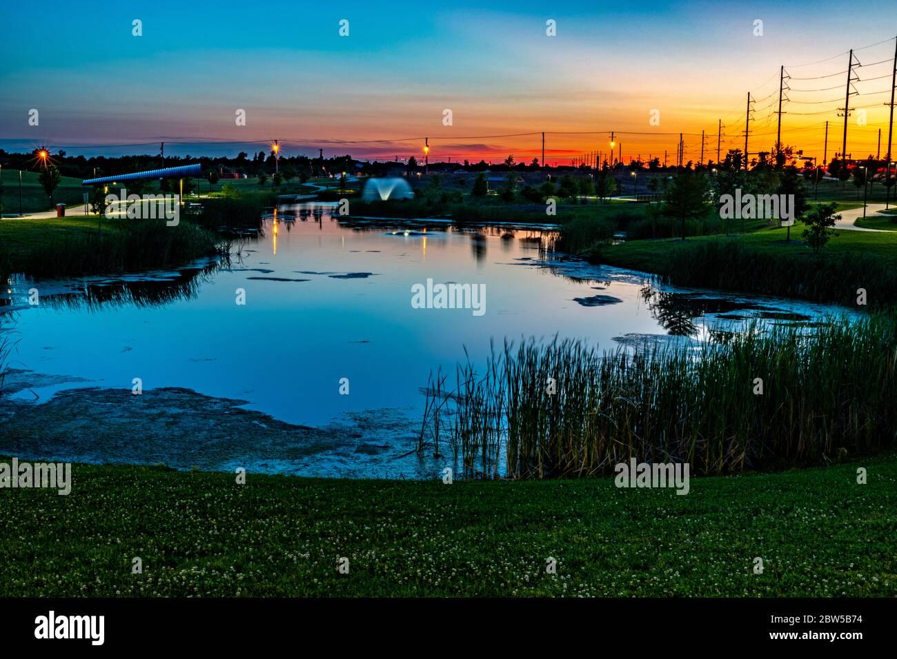 Sunset over Mercy Park in Joplin, Missouri Stock Photo