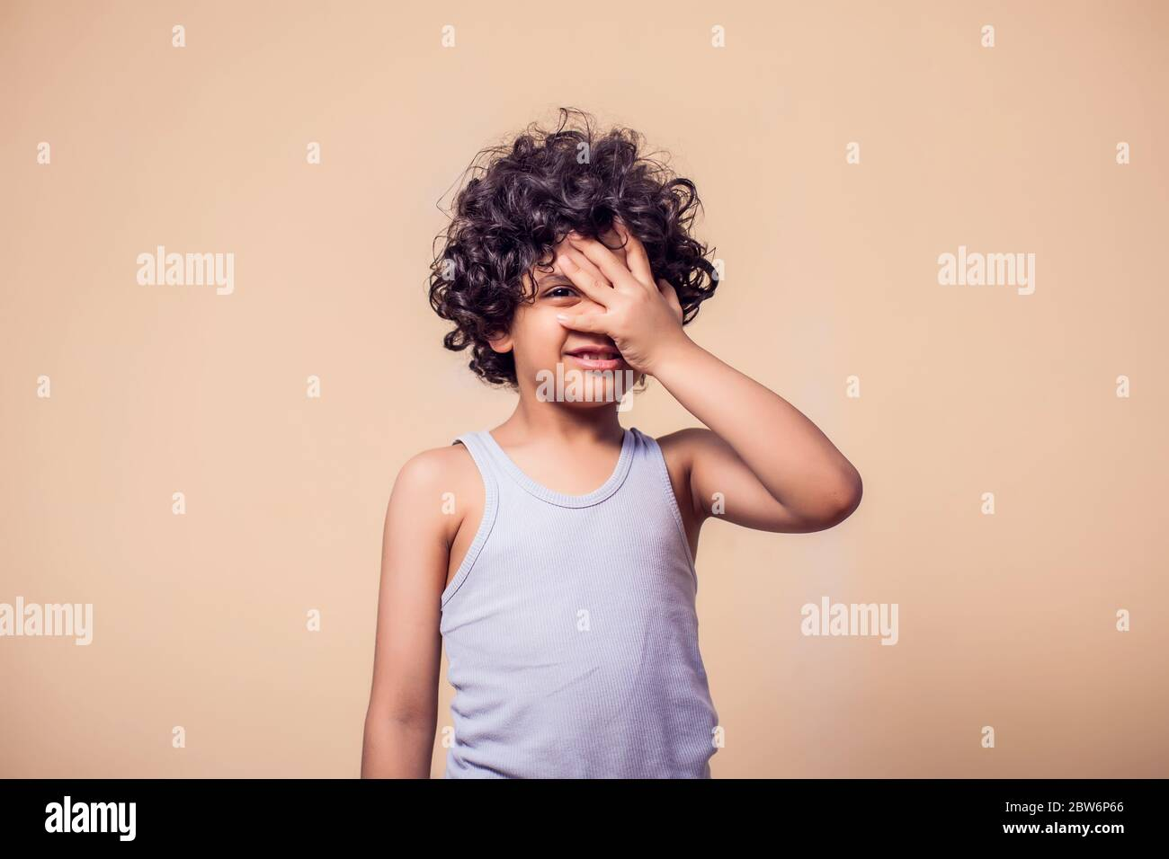 A Portrait Of Sad Kid Boy With Curly Hair Children And Emotions Concept Stock Photo Alamy