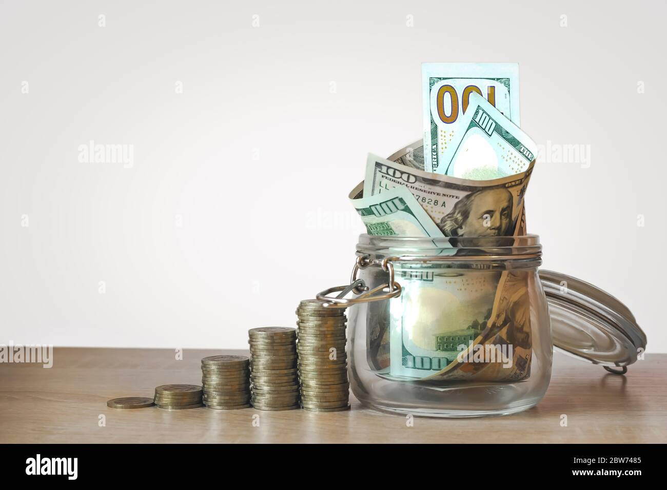 Coins Stack And Us Dollar Bills In The Glass Jar Concept Of Money Saving Financial Savings Money And Income Investment Ideas And Financial Manageme Stock Photo Alamy