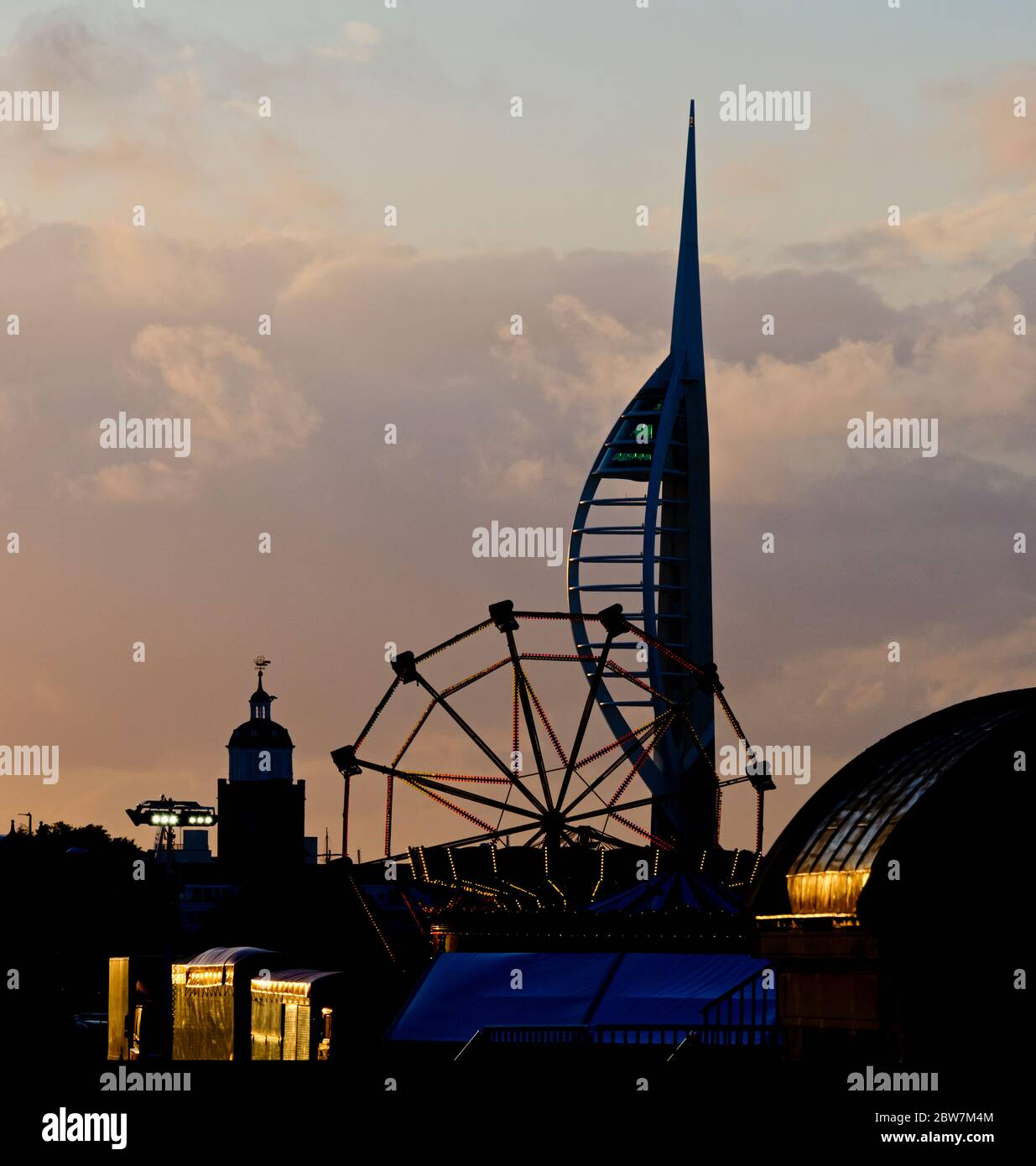 View at sunset of Portsmouth Cathedral, the Spinnaker Tower and a fairground on Southsea Common, taken from the Royal Naval War Memorial Stock Photo