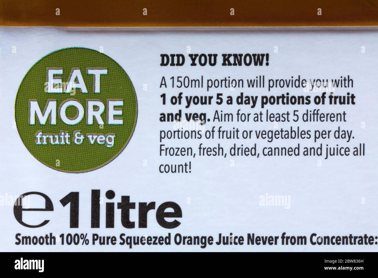 Eat more fruit & veg information on carton of Iceland 100% pure squeezed smooth orange juice Stock Photo