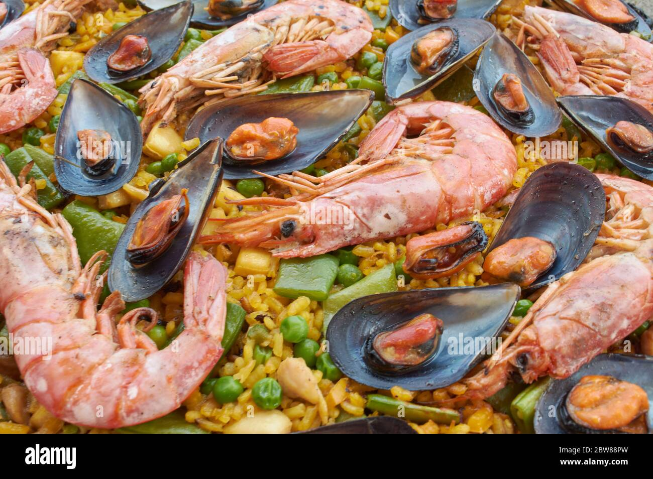 Traditional Spanish Paella with seafood vegetable meat, and rice Stock Photo