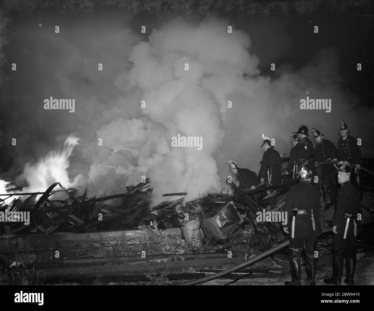 A fire at the motor car wreckers and builders yard in Bexley , London . 1938 Stock Photo