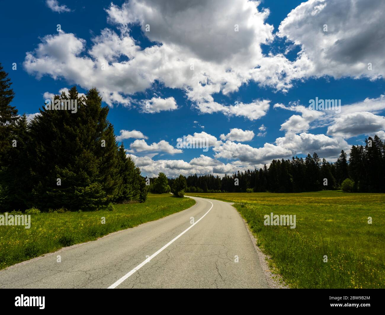 Countryside countryroad sunshine with numerous Spring clouds Sunger in Croatia Europe Stock Photo