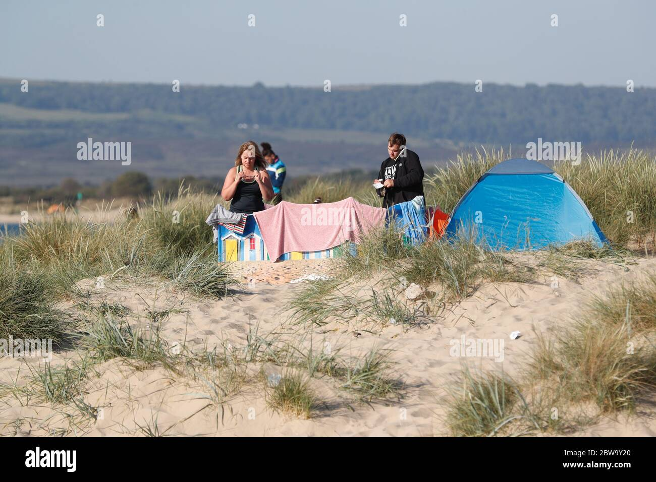 Poole, UK. 31st May 2020.    The Early birds  setting up for the day at Sandbanks beach, Poole, Dorset Credit: Richard Crease/Alamy Live News Stock Photo