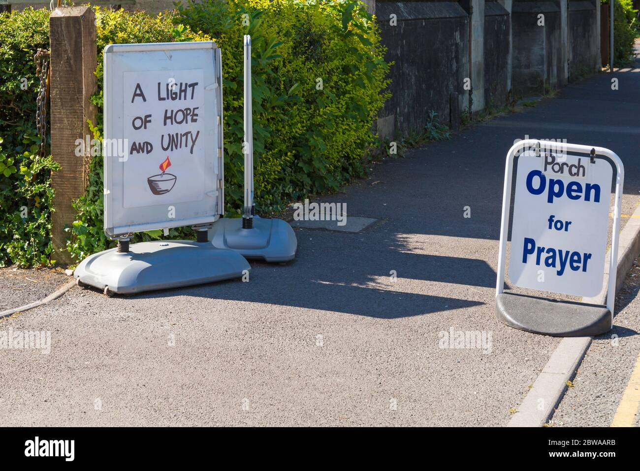 Poole, Dorset UK. 31st May 2020. A light of hope and unity - porch open for prayer signs outside St Aldhelm's Church, Branksome, Poole during Coronavirus Covid 19 pandemic lockdown. Credit: Carolyn Jenkins/Alamy Live News Stock Photo