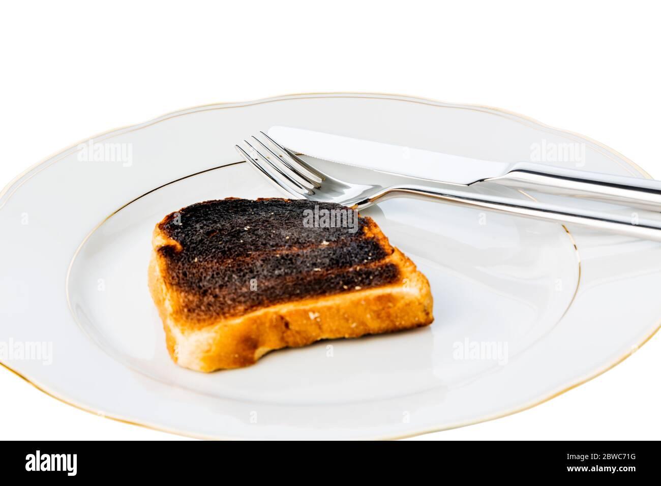 Toastbrot wurde beim toasten verbrannt. Verbrannte Toastscheiben beim Fruehstueck. Stock Photo