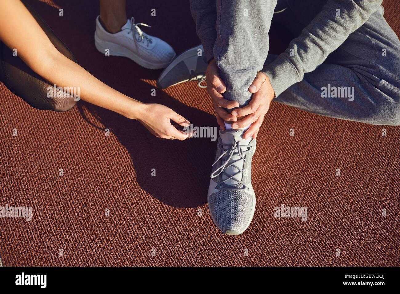 Knee injury in training.Man injured his leg during exercise. Stock Photo