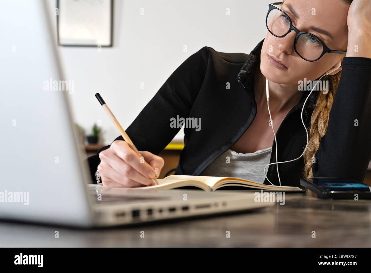 tired business woman working online or study education using laptop note pad, Remote working. Online teacher or Coach Stock Photo