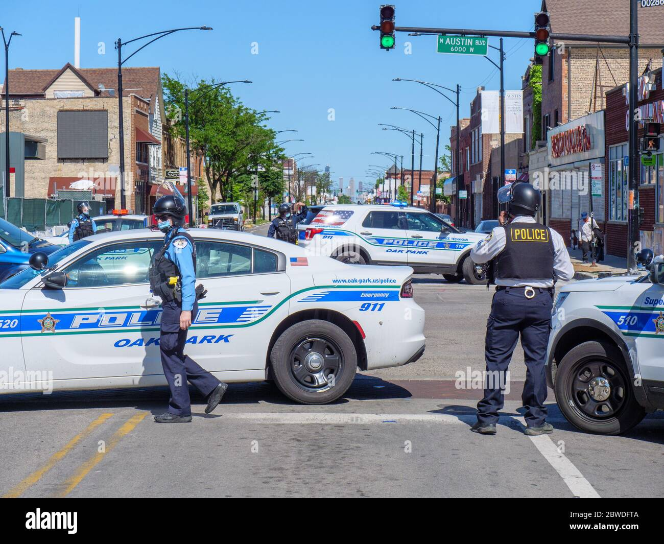 Oak Park, Illinois. 31st August 2020. Oak Park Police officers and vehicles block Chicago Avenue at Austin Boulevard, the border with the City of Chicago. Chicago Police requested closure of the street due to civil unrest resulting from protests of the death of George Floyd, a black man killed by a Minneapolis, Minnesota policeman, who has been charged with murder. This view is to the east from Oak Park into the city. Stock Photo