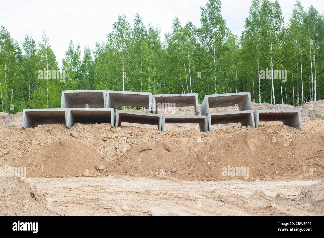 Reinforced concrete slabs for heating. Modern plates for preserving the waterproofing of the heating main Stock Photo