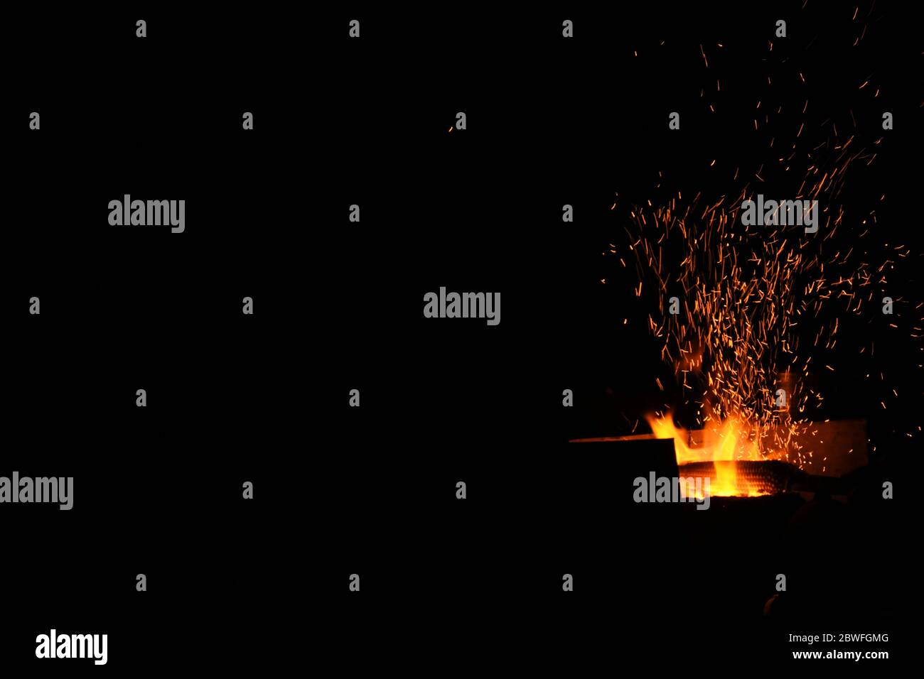 Amazing Sparks in the Dark. Beautiful abstract background on the theme of fire, light and life. Sparks fly in the sky Stock Photo