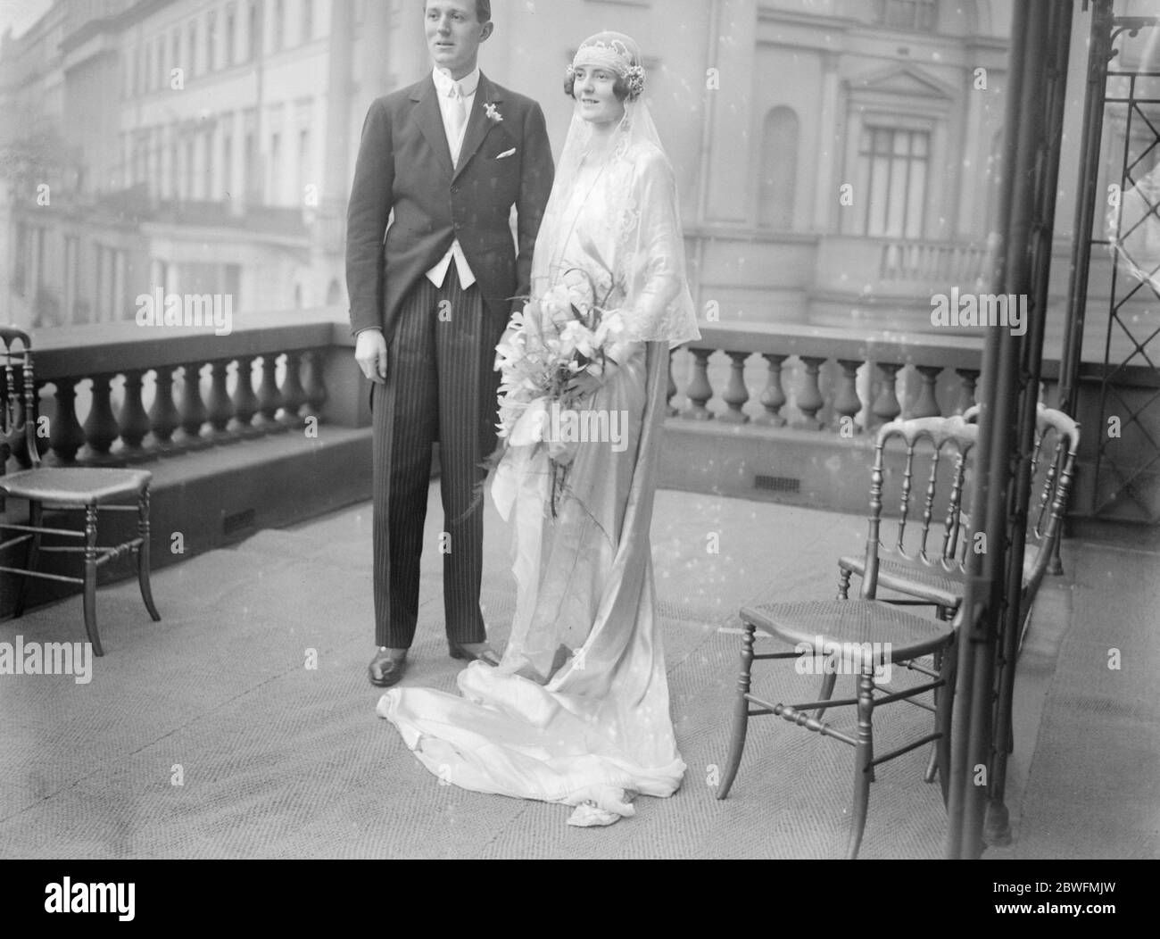 Bridal retinue of children . There was a retinue of children for Miss June Chaplin , at her wedding to Mr Rudolph de Trafford , which took place at St James 's , Spanish Place . Bride and bridegroom photographed at the reception . 7 February 1924 Stock Photo