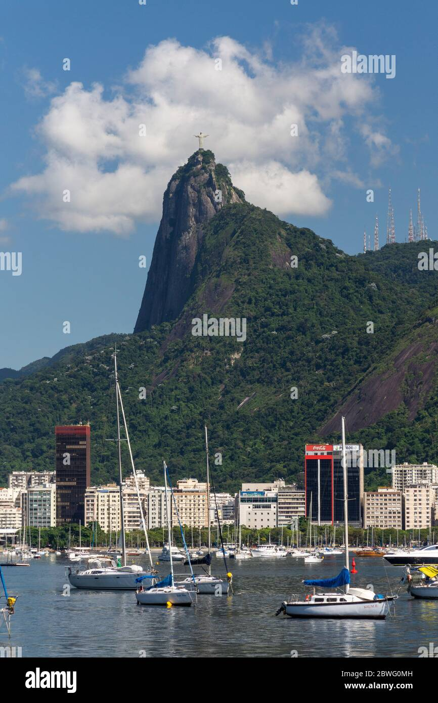 Beautiful view to docked sail boats and Corcovado Mountain with Christ the Redeemer Statue, Rio de Janeiro, Brazil Stock Photo