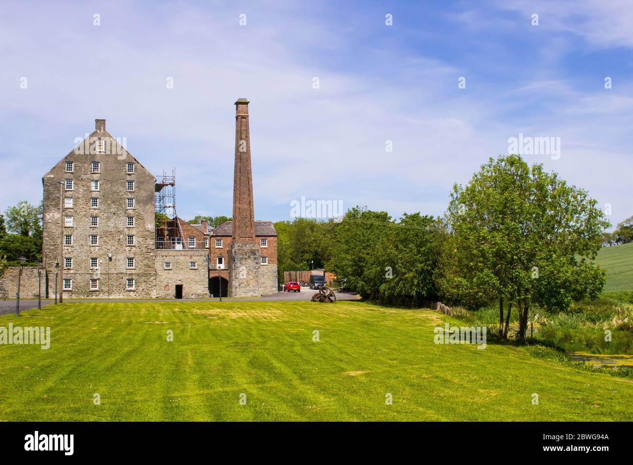 31 May 2020 The historic Ballydugan flourmill and chimney stack located near Downpatrick in County Down Northern Ireland. This restored building is no Stock Photo