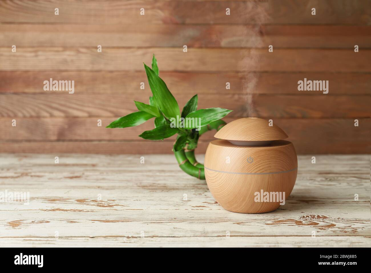 Aroma Oil Diffuser On Wooden Background Stock Photo Alamy