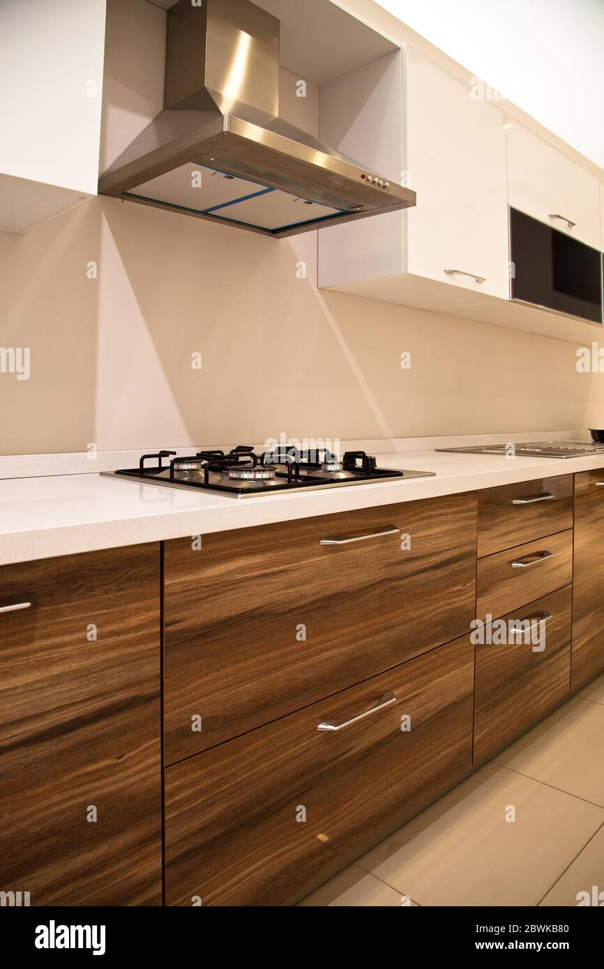 Interior Of Modern Kitchen Equipment White And Walnut Cabinets Stock Photo Alamy
