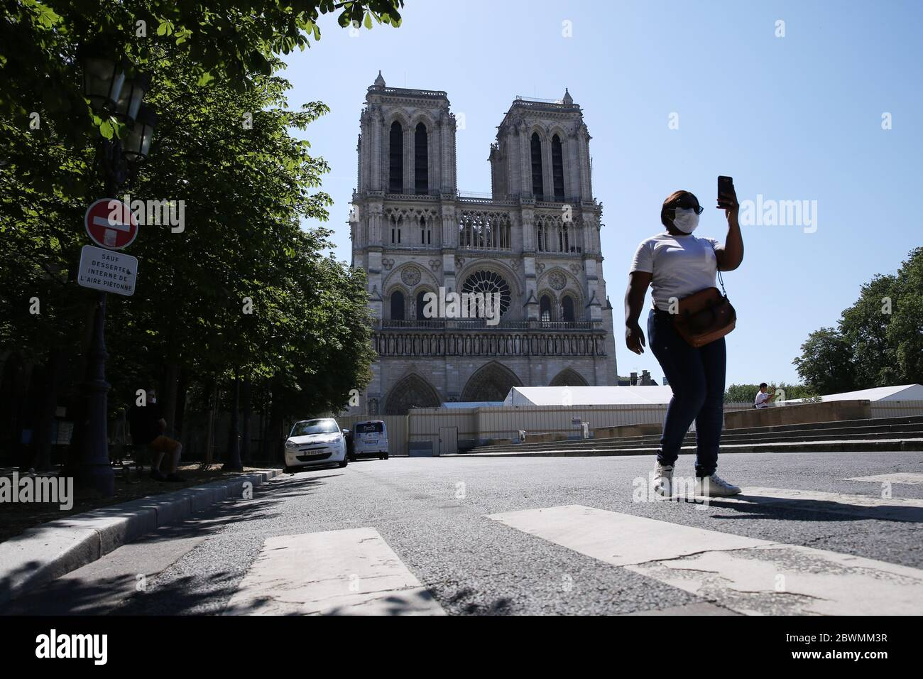 Paris, June 2. 15th Apr, 2019. A woman walks in front of the Notre-Dame Cathedral in Paris, France, June 2, 2020. The Parvis Notre-Dame was reopened to the public from May 31 after more than one year's close because of the huge fire on April 15, 2019. Credit: Gao Jing/Xinhua/Alamy Live News Stock Photo