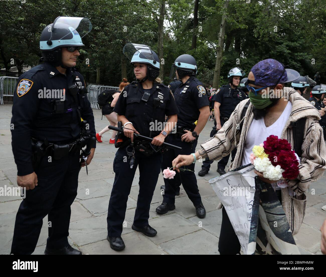 A photo of the arrest of a protesting woman who gave flowers to the US  military – صراط عشق