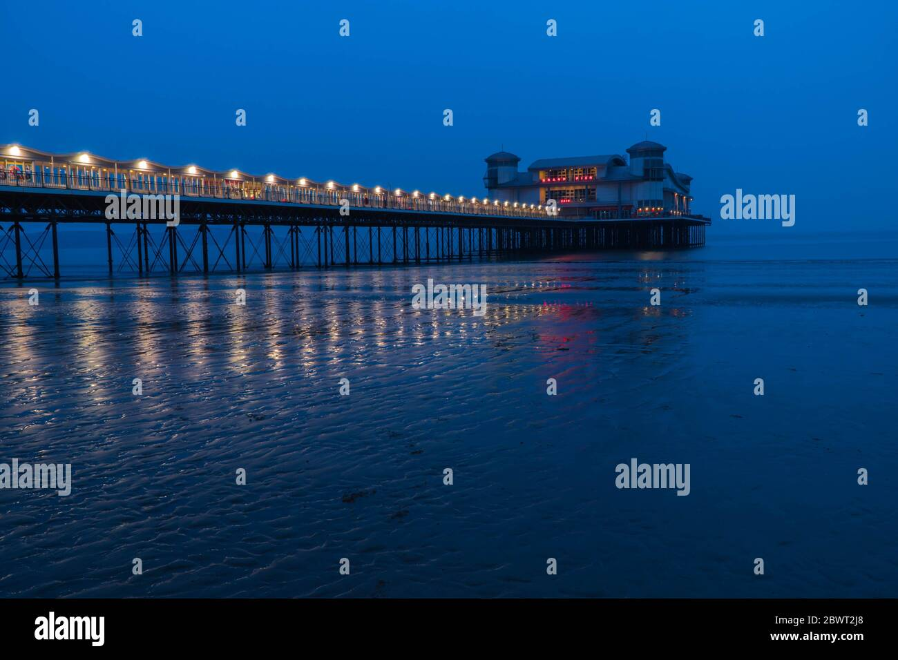 The Grand Pier reaching out into the Bristol Channel at Weston-super-Mare, Somersert England UK. April 2019. Stock Photo