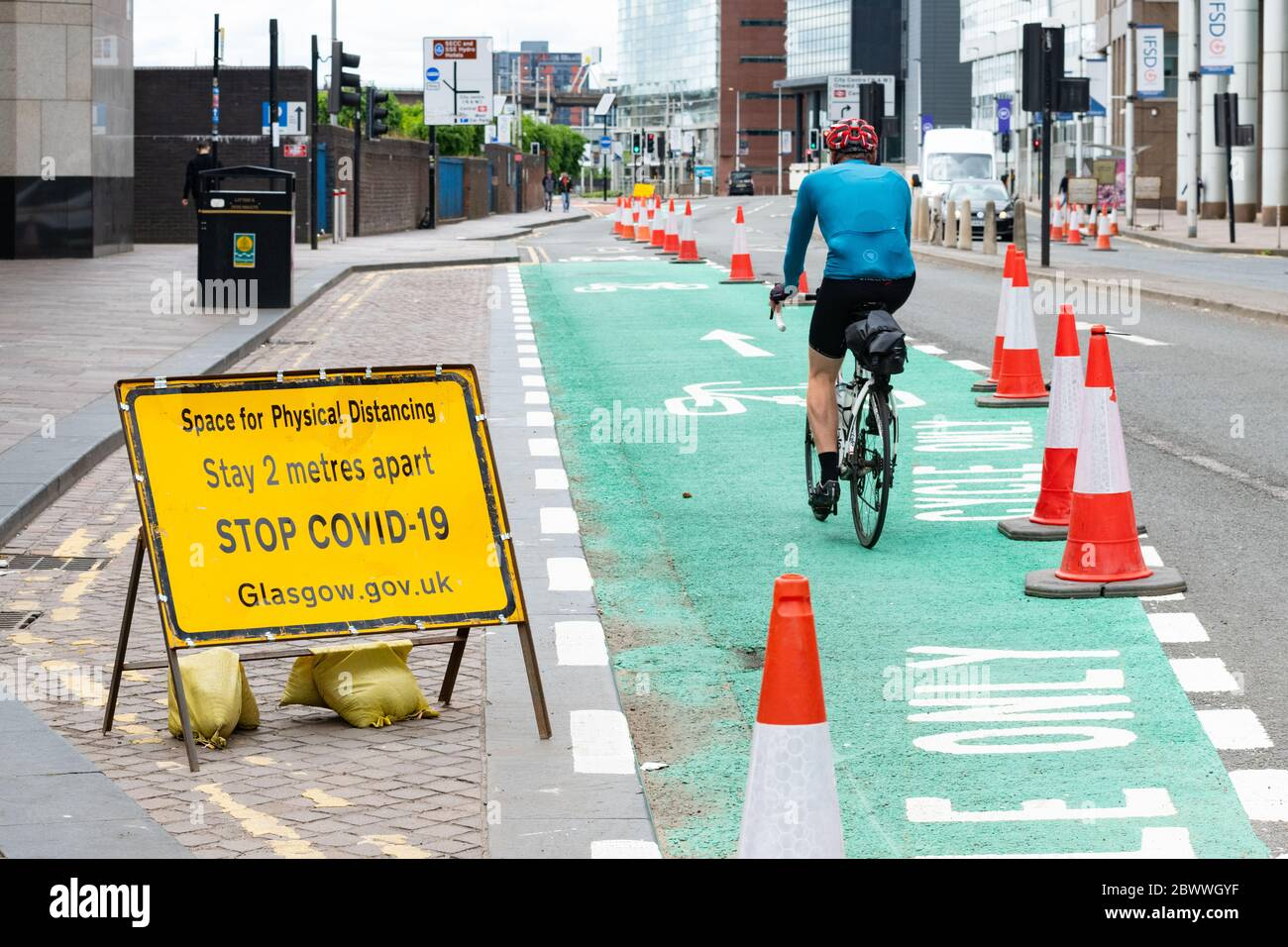 Glasgow, Scotland, UK. 3rd June, 2020. cyclists in Glasgow making use of quiet streets and existing and new cycle lanes (here shown temporary cycle lane along the Broomielaw) on World Bicycle Day 2020 Credit: Kay Roxby/Alamy Live News Stock Photo
