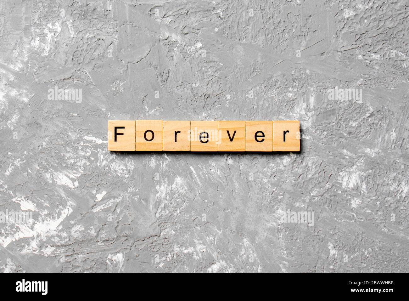 forever word written on wood block. forever text on table, concept. Stock Photo