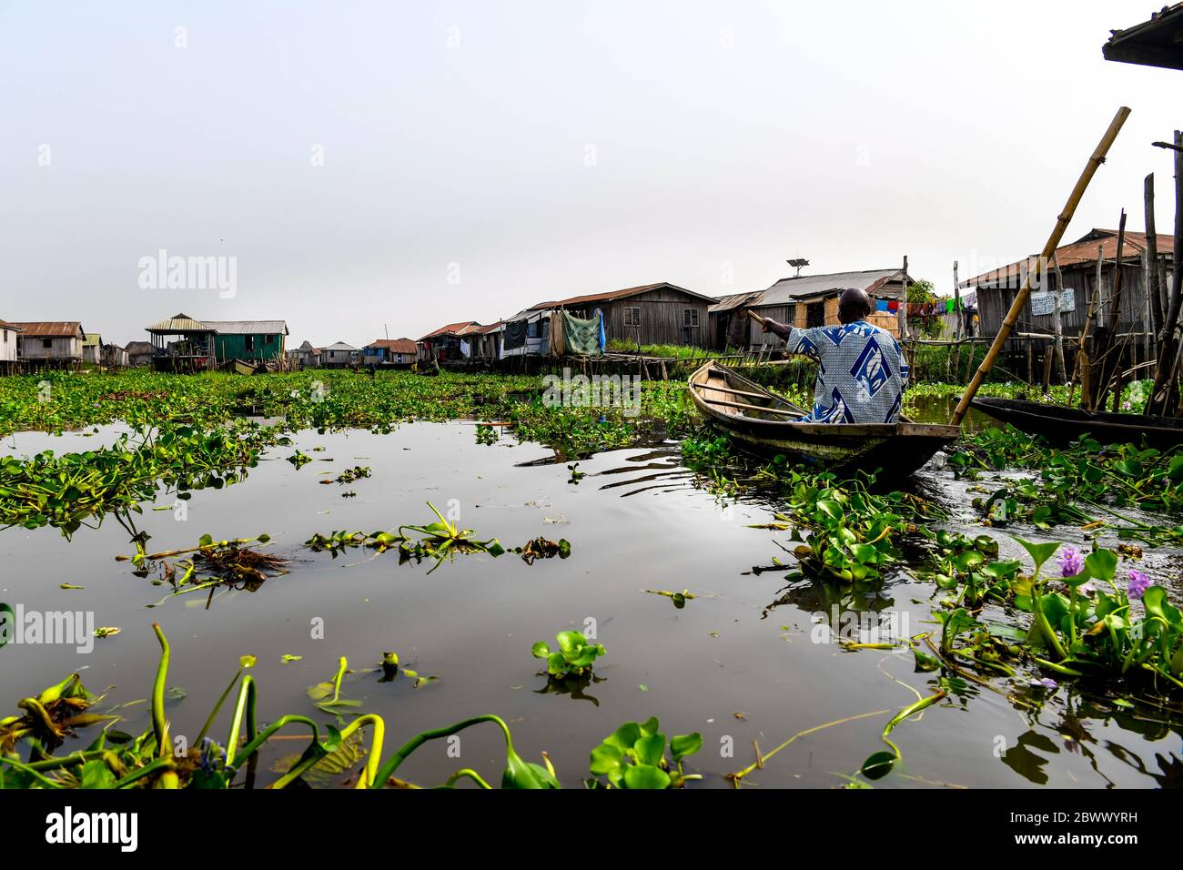 Africa, West Africa, Benin, Lake Nokoue, Ganvié. Pirogues in the water streets of the lakeside town of Ganvié. Stock Photo