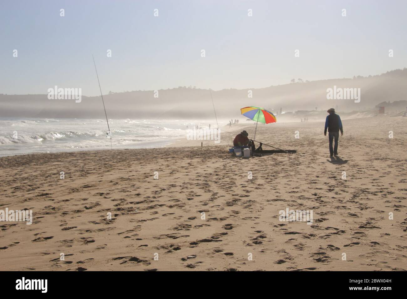 The beach of Wilderness and wild Indian Ocean on Garden Route, South Africa, Africa. An angler on the beach. Stock Photo