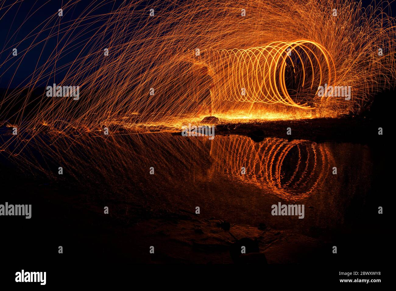 Long exposure and steel wool in the rockery on the beach of Balikliova Stock Photo