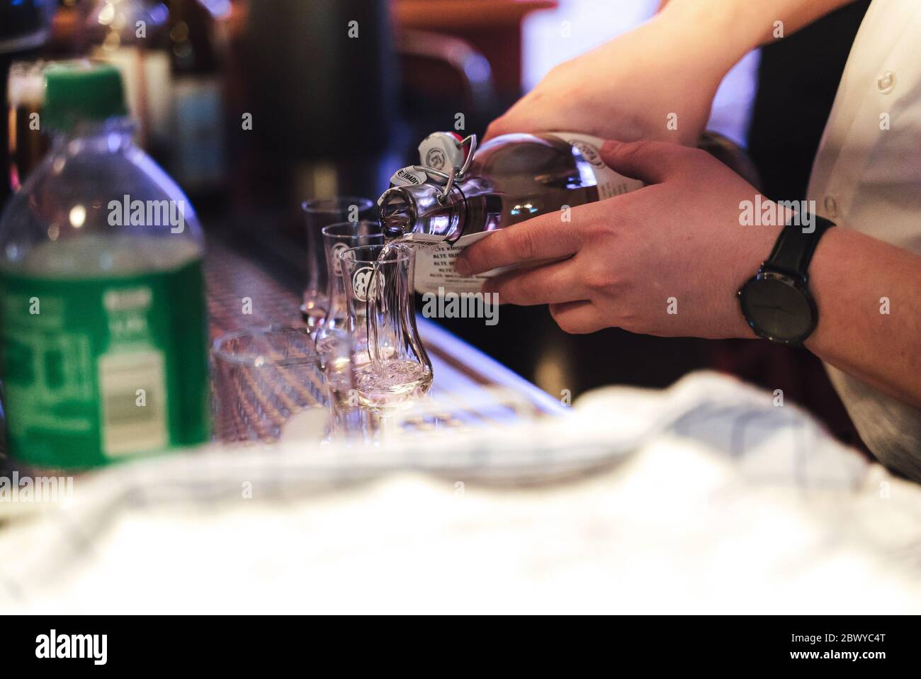 Man Preparing Drink At Bar Closeup Of Male Hands Pouring Transparent Alcoholic Drink From Bottle Celebration Birthday Party Wedding Concept Stock Photo Alamy