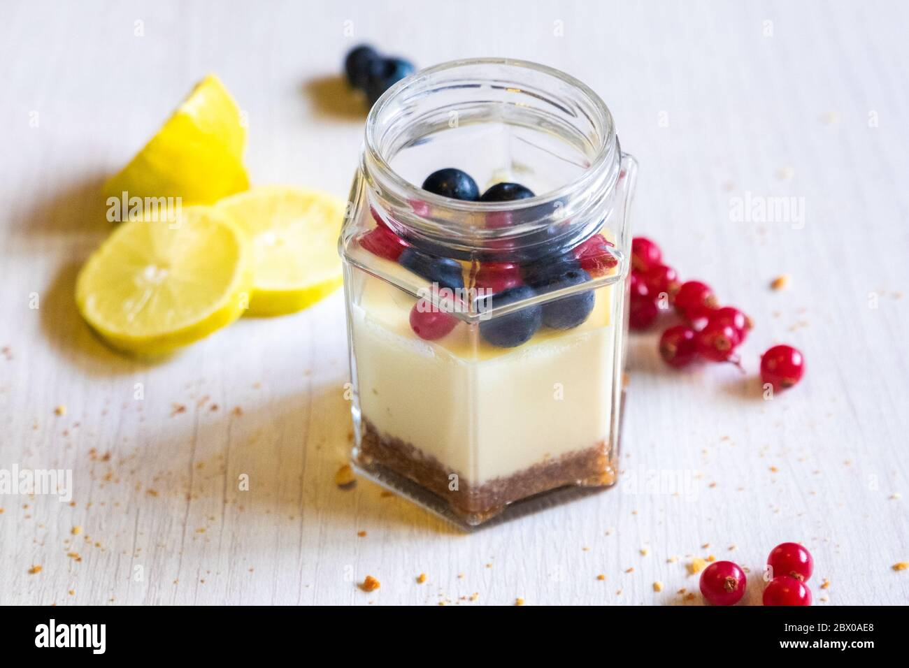 Sous Vide Cheesecake In A Jar Dinner S Perspective Photo With Lemon Wedge And Berries Garnish Bright Background Stock Photo Alamy