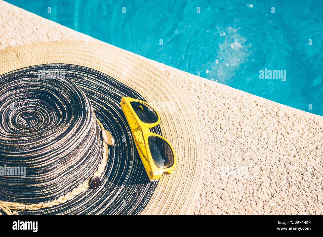 Sunglasses on the edge of the pool - the holiday season - rest and recovery Stock Photo