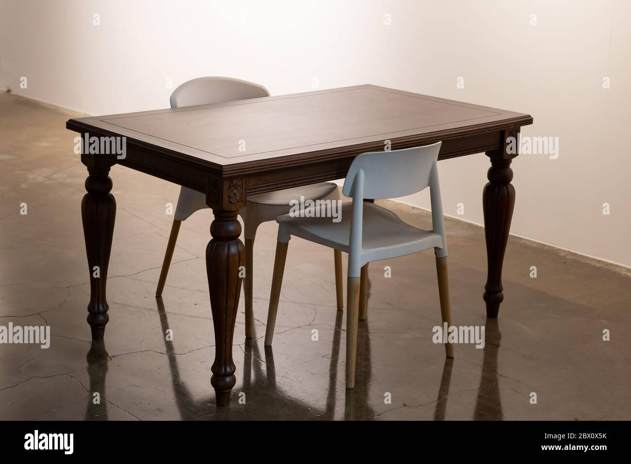 Picture of: Classical Tables And Modern Chairs Stock Photo Alamy