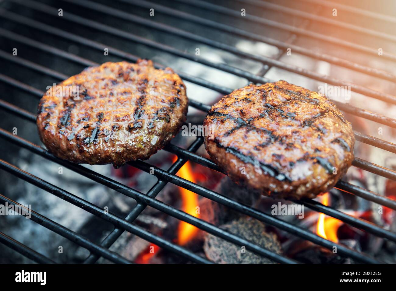 Beef Burger Meat Cooking On Charcoal Grill Outdoors Stock Photo Alamy