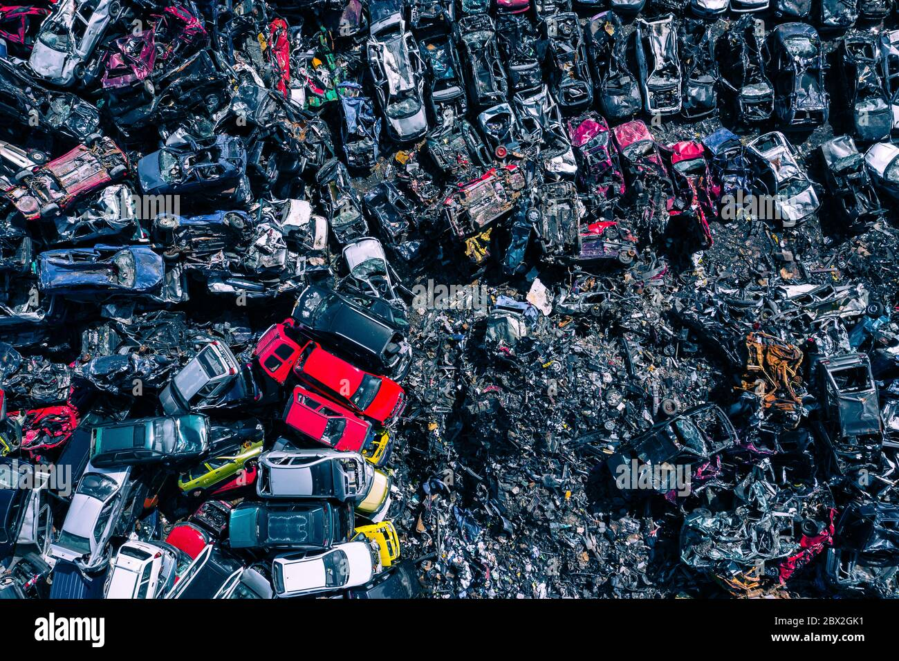 Scrapyard Aerial View. Old rusty corroded cars in car junkyard. Car recycling industry from above. Stock Photo