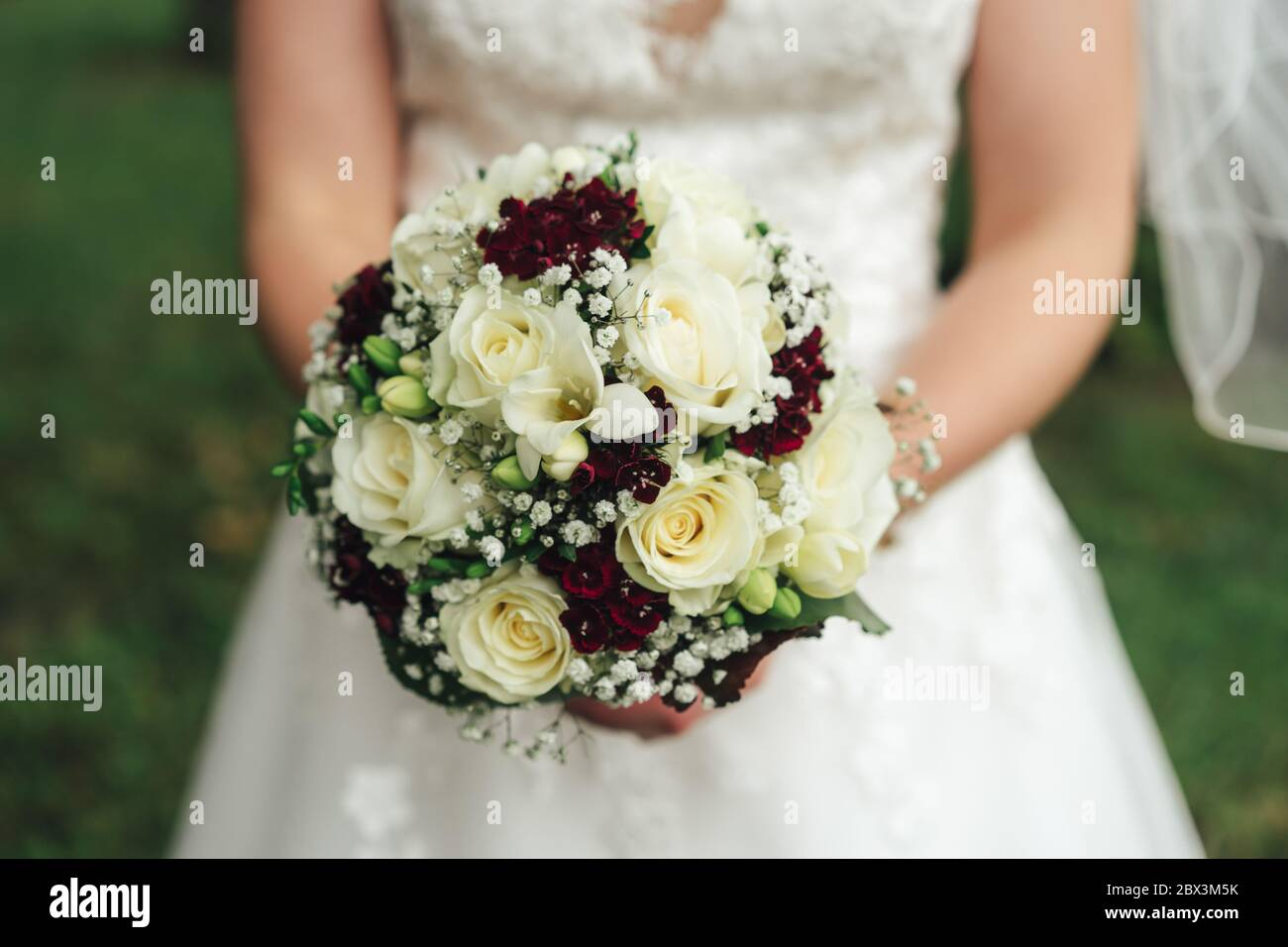 Close Up Wedding Bouquet White And Red Flowers Bride Holding Flowers In Her Hands Outdoor Background Wedding Day Concept Stock Photo Alamy