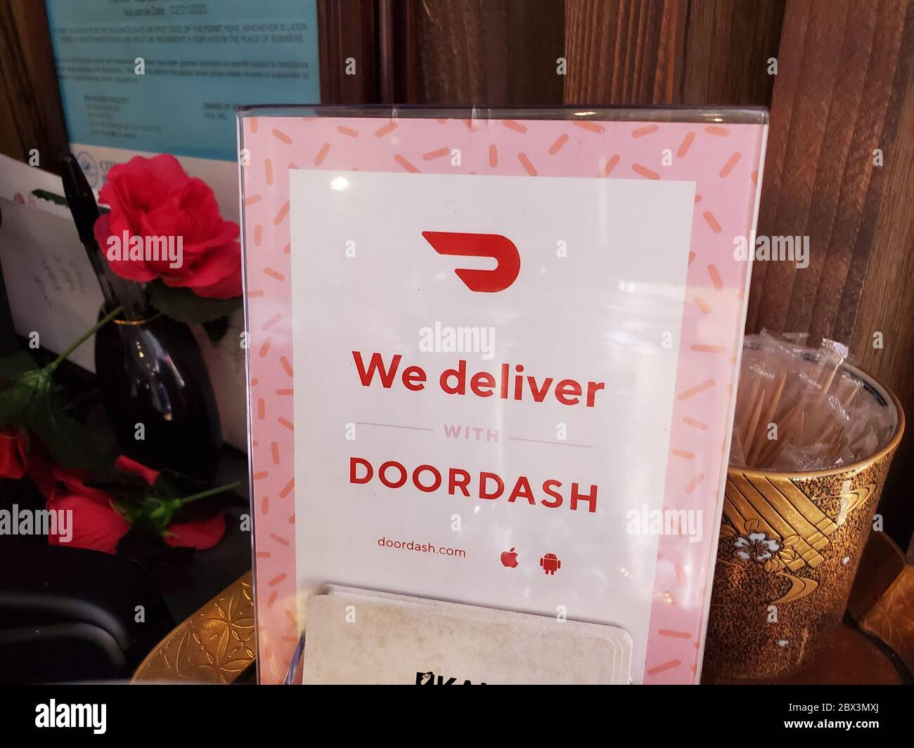 Sign reading We Deliver on Doordash in a restaurant setting, San Ramon, California, April 17, 2020. () Stock Photo
