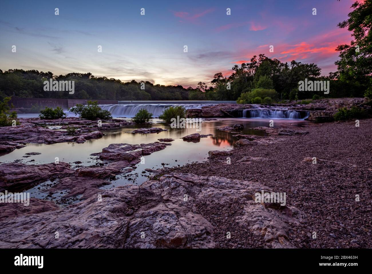 Sunset skies over Grand Falls waterfall in Joplin, Missouri Stock Photo