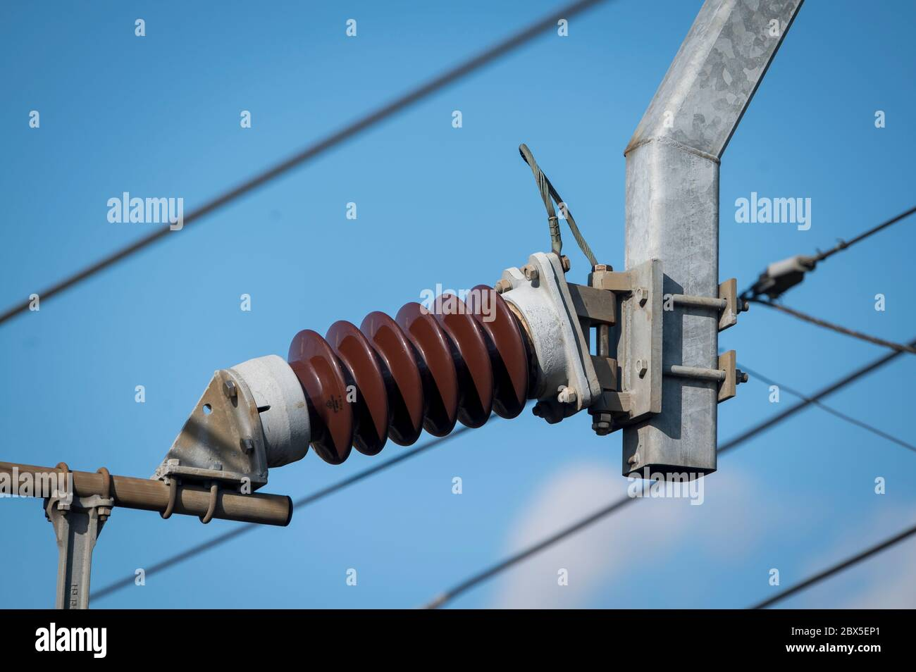 Ceramic insulator and catenary on an electrified railway line in the UK. Stock Photo