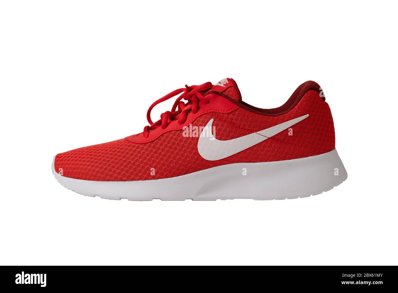 semanal ven acuerdo  Red sneakers of Nike brand. Shoes with laces for jogging and fitness.  Stylish youth model. Object cut out on white background. Side view. May,  2019 Stock Photo - Alamy
