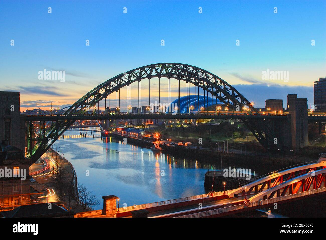 The Tyne Bridge in the blue hour at dawn spanning the River Tyne linking Newcastle and Gateshead in Tyne and Wear, North-East England. Stock Photo