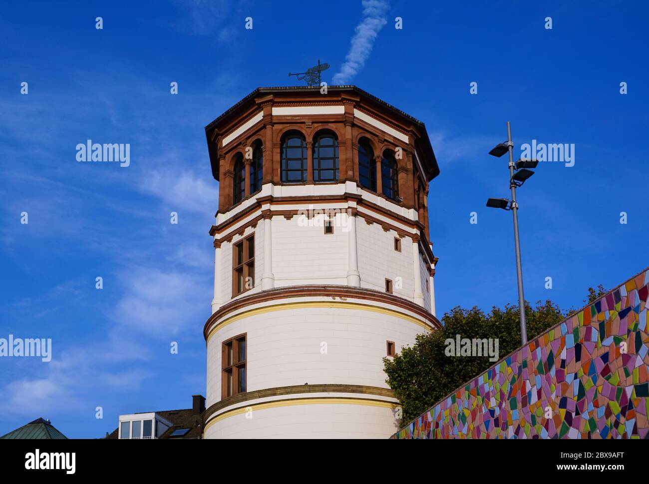 """""""Schlossturm"""" at Burgplatz in Düsseldorf Old Town, which once belonged to a castle that was destroyed in the year 1872. Stock Photo"""