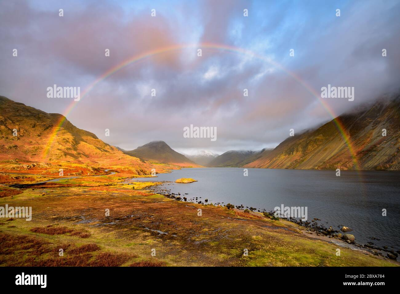 Full rainbow over dramatic landscape view of Wastwater lake in The Lake District National Park, United Kingdom. Stock Photo