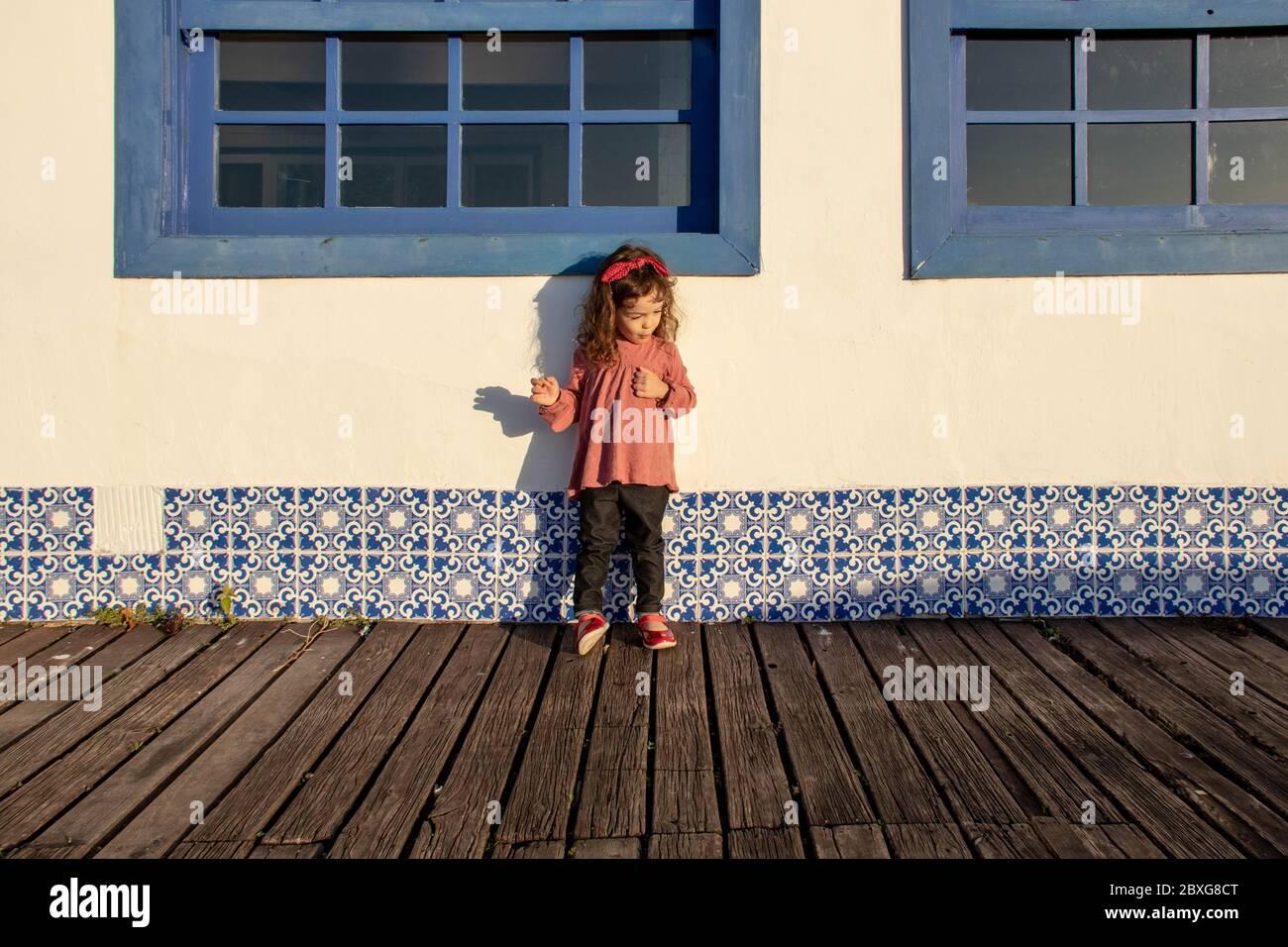 Girl standing on a wooden boardwalk, Armacao dos Buzios, Rio de Janeiro, Brazil Stock Photo