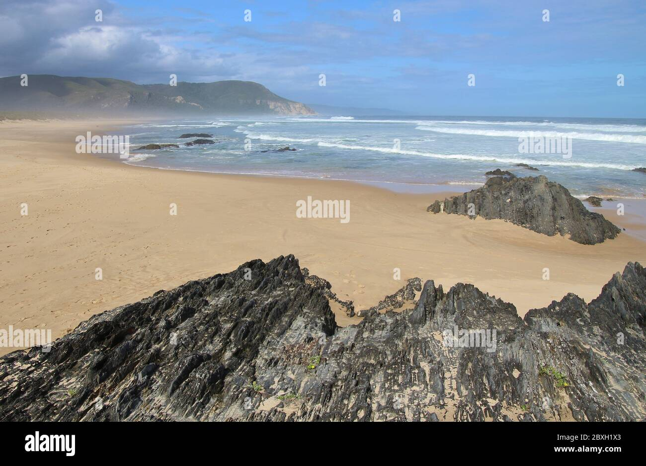 Cragged cliffs on the beach of Nature's Valley, Garden Route, South Africa, Africa. Stock Photo
